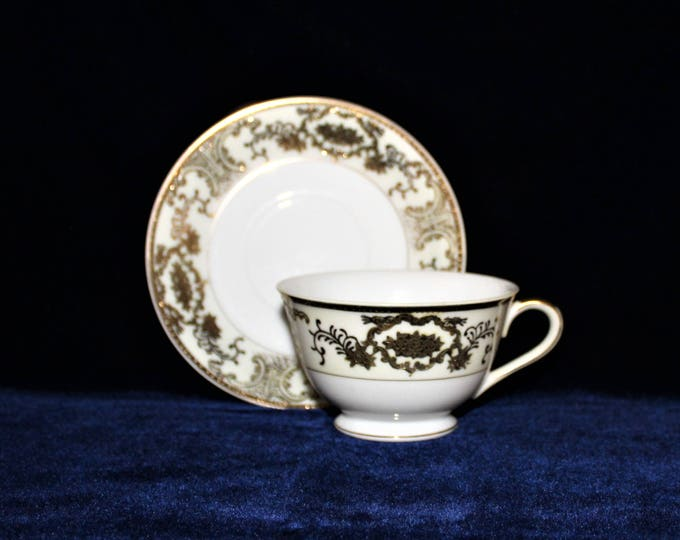 Vintage Tea Cup and Saucer White with metallic gold Moriage and embossed details by Gold Coast China
