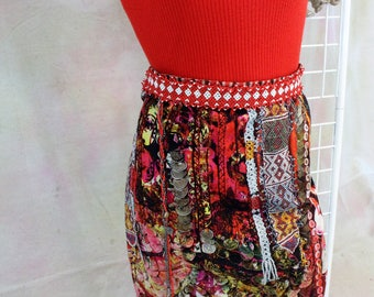 Desigual Skirt Size 42  Beaded front waistband  Beaded and chain accent  Coin print  Tribal colors Print Gathered hem  New Condition No Tags