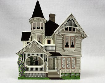 Shelia's Collectible Drain House. it is a 1891 historical house replica located in  Drain Oregon. It's autographed as well as numbered.
