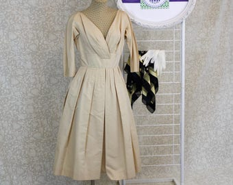 1950's Gold Satin Cocktail Dress with Plunging neckline.  Vintage Dress with Fitted Waist and Full Skirt size Small.