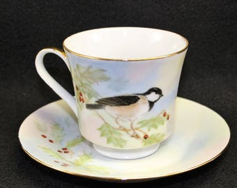 Christmas Bird Tea Cup and Saucer featuring bird holly berries and leaves.  Hand painted and signed vintage cup.