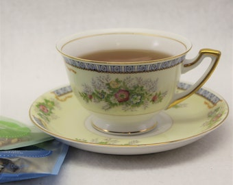 Meito Vintage Tea Cup and Saucer.  Lovely Hand Painted Floral tea cup in pastel yellow and blue colors