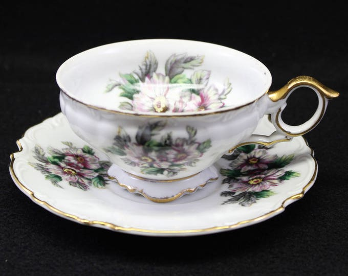 Purple Flower tea cup and saucer by Ucago.  Floral Fluted and Embossed tea cup and saucer.