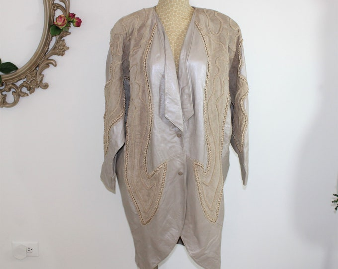Women's leather coat size L XL. Beige metallic leather and suede over sized jacket highly embellished by Norma of Canada circa 1980's.