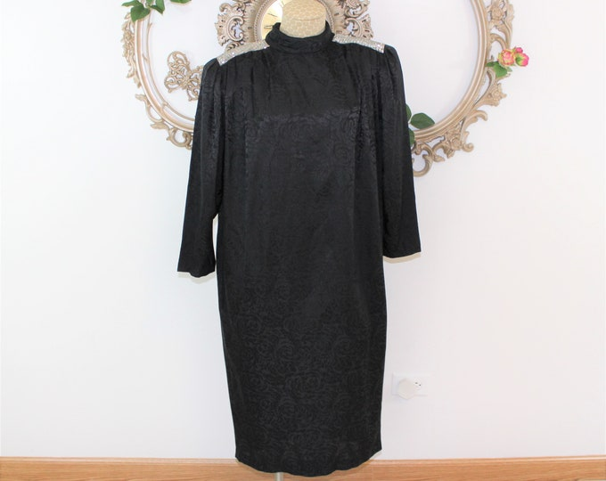 Black silk dress with beaded shoulders in size 10.  Black and silver Cocktail holiday party dress made by Argenti.