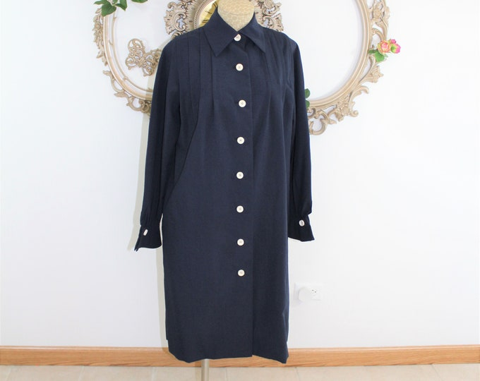 Navy blue shirt dress in vintage size 10.  Classic style long sleeve dress in silk blend with button front.