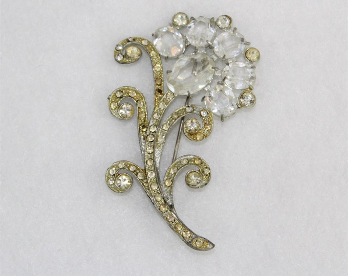 1920's Large Brooch in Floral Design with Clear Glass Rhinestones and pale yellow stones in a silver toned open back setting.