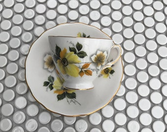 Tea Cup and Saucer. Royal Vale Yellow and White Fluted Tea Cup and Saucer with Yellow Dogwood Blossoms.