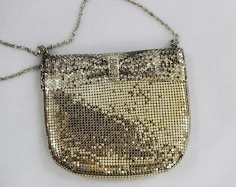 Silver metal mesh purse by Yuewton.  Vintage designer evening bag with rhinestone accents and long strap.