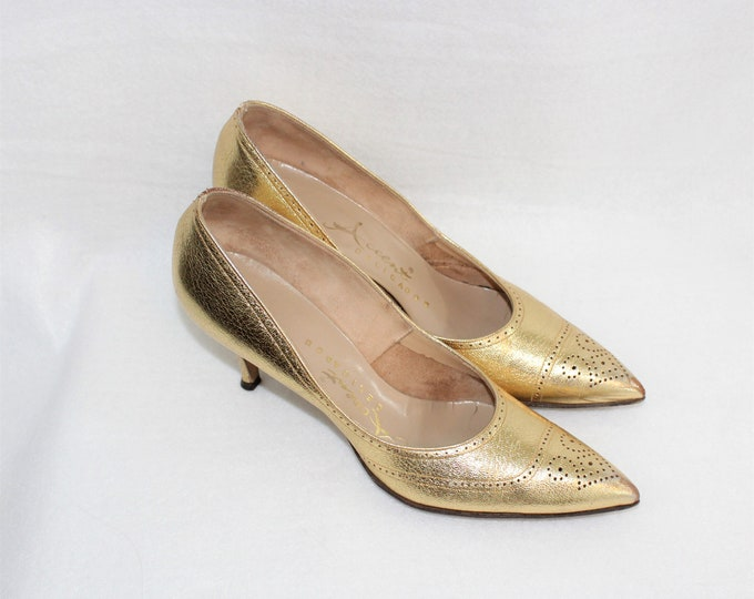Women's Shoes. Metallic Gold Pumps in size 7 1/2 AA Narrow width with pointed toes with Spectator Details, cut outs and stitching.