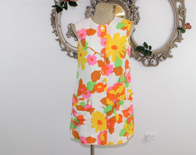 Summer Dress. 1960's MOD short sleeveless dress with bright colored flowers in size S small from Bonwit Teller.  Mini dress with buttons.