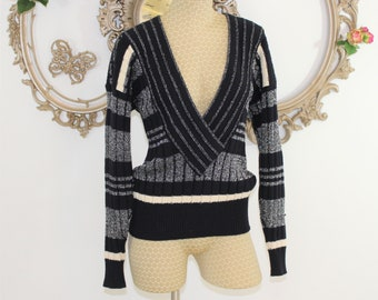 Escada sweater, 1980' s by Margaretha Ley. V-neck, silver thread pullover one size fits all.