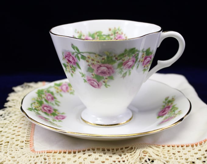 Vintage Rose Tea Cup and Saucer by Clarence.  English Pink Roses Tea cup Hallmarked Clarence Bone China, Numbered fluted Teacup