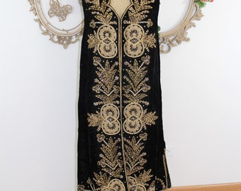 Vintage beaded long vest  Heavily embellished in gold faux pearls.