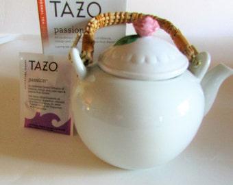 Vintage rattan handle teapot.
