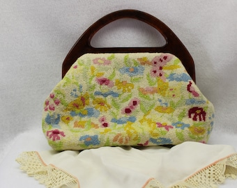 Needlepoint purse with faux tortoise shell handles.