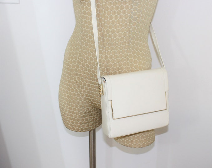 Leather purse.  Vintage Cream colored leather shoulder bag with gold metal hardware. Structured cross body purse with long adjustable strap.