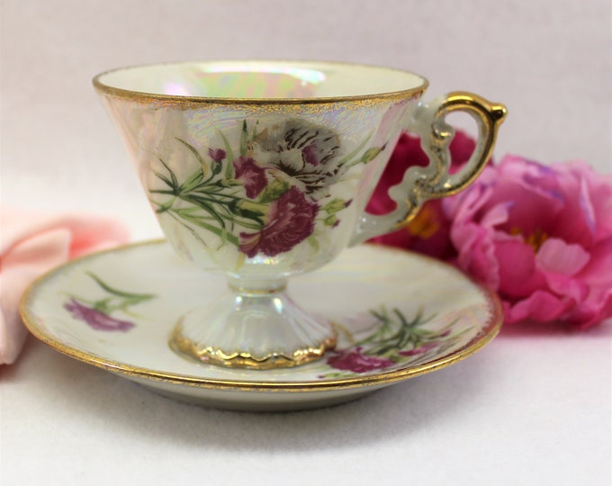 JANUARY Tea Cup and Saucer by Ucagco with iridescent finish and carnation flowers. Tea cup of the month collectible.