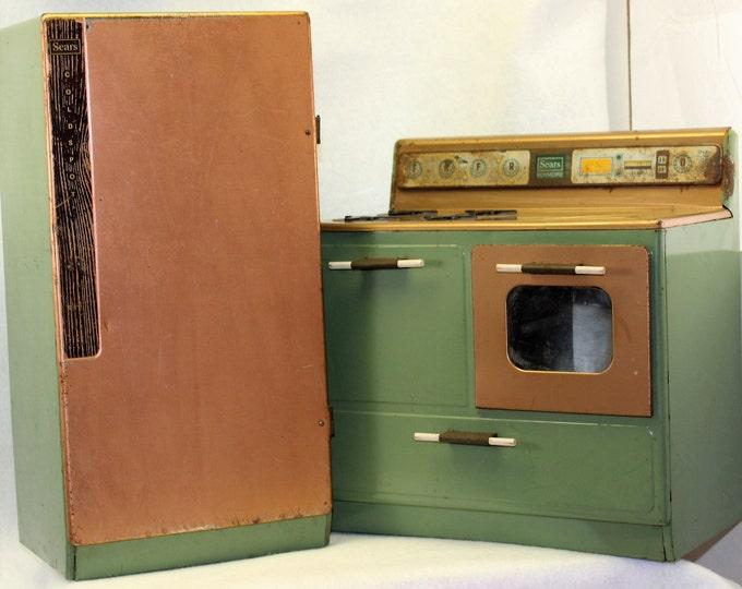 Vintage Kenmore children's tin toy.