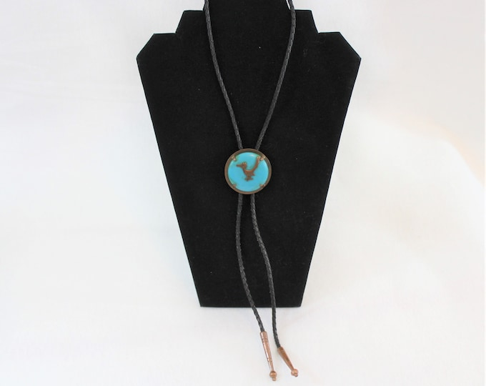 Vintage Copper Bolo Tie with Black Leather Lariat featuring a Roadrunner bird motif on Turquoise colored stone.
