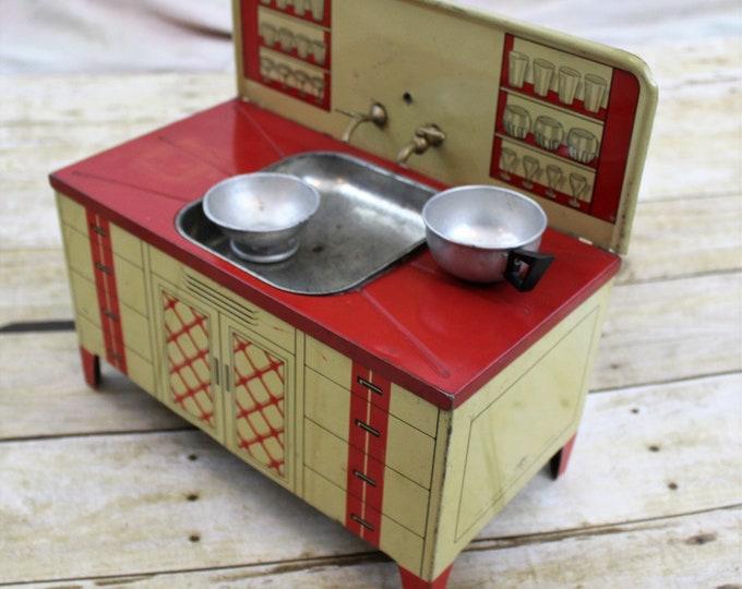 Vintage Wolverine tin  litho children's sink. Tin Toy
