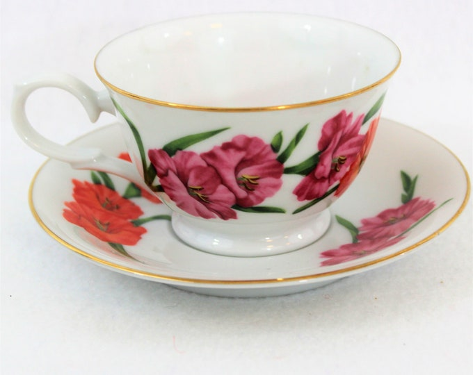 Avon Gladiolus Tea Cup and Saucer circa 1991.  Blossoms of the month Collectible Tea Cup and Saucer.