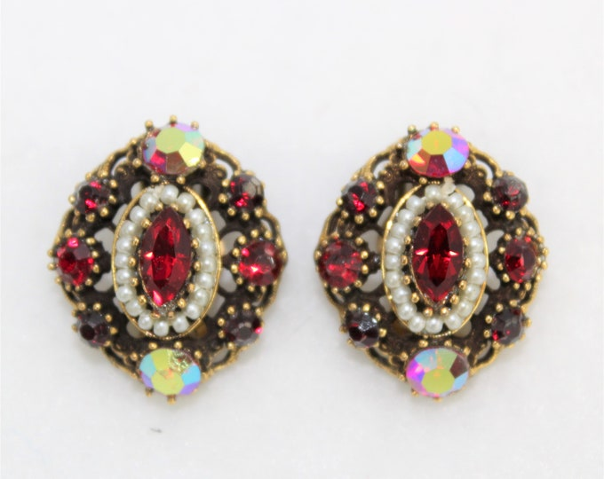 Weiss Clip Earrings with iridescent stones, faux pearl accents and stones in round and marquis shapes. Red oval earrings vintage