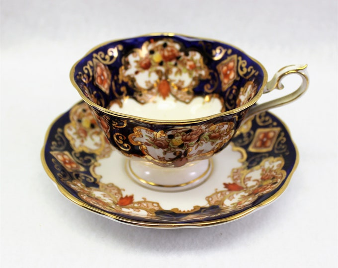 Royal Albert Tea Cup and Saucer Pattern HEIRLOOM in Avon Shape.  Vintage tea cup in Deep Blue, Gold and Orange