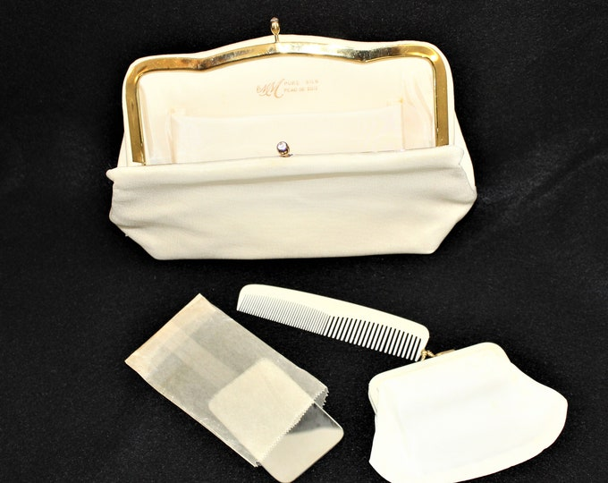 Cream Colored Silk clutch with rhinestone kiss clasp, original Coin Purse, Comb and Mirror in never used condition.  Vintage purse by MM