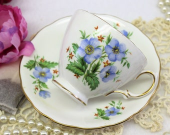 Tea Cup and Saucer perfect for Bridesmaid Tea Party. Colclough tea cup and saucer with blue flowers.  Mad Hatters Party