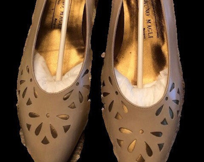 Beige leather 3 inch Pumps by Bruno Magli in size 10.5M  beautiful cut outs Unworn vintage in original box Made in Italy.