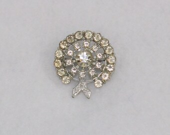 Vintage Round Rhinestone Pin or Brooch with clear glass stones in silver toned setting.