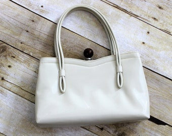 Crown Lewis Patent Leather Handbag.  1960's top handled purse with Lucite Ball snap closure.