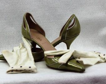 A pair of green PRADA pumps size 36.
