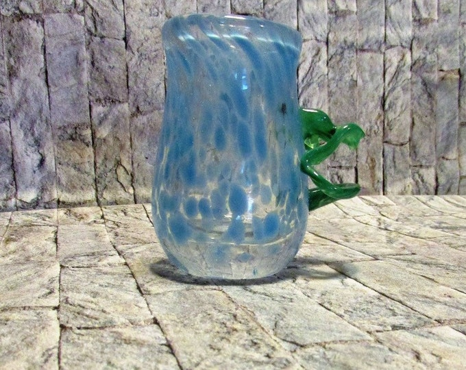 Vintage hand blown vase. Unique blue spatter bud vase with a cool green handle.