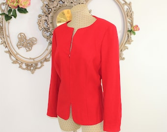 Red ESCADA jacket vintage with original tags featuring zippered front and buttons around cuffs in Euro size 42 USA vtg size 12.  Luxury good