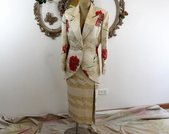 Woman's formal Oro Solo suit in Size 14. Ornate metallic gold long skirt and flowered jacket.