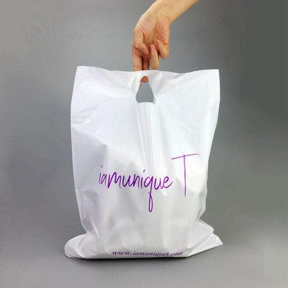 custom die cut bags, custom merchandise bag, custom die cut handle bags,  pink shopping bags with custom logo