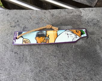 Bookmark made from recycled skateboard