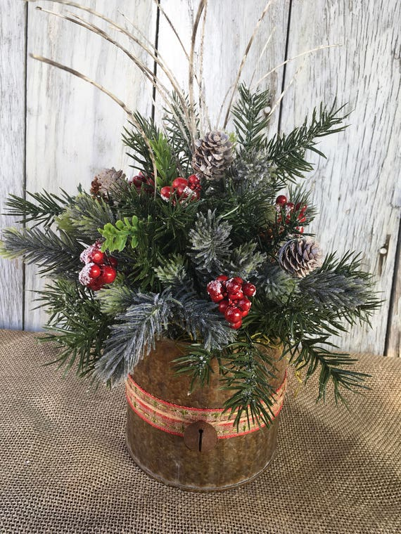 A Christmas Arrangement.A Christmas Arrangement In A Galvanized Tin Winter Centerpiece With Pine Cones And Red Berries Winter Arrangement Holiday Decor