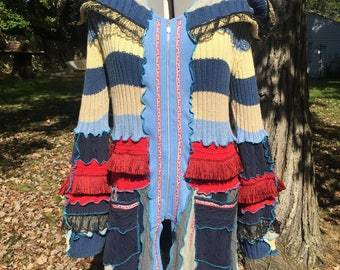 Deconstructed sweater coat, wool free, fringe, size XL with stretch, Katwise trim, called Crouching Lion