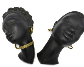 Plaster wall masks, African couple