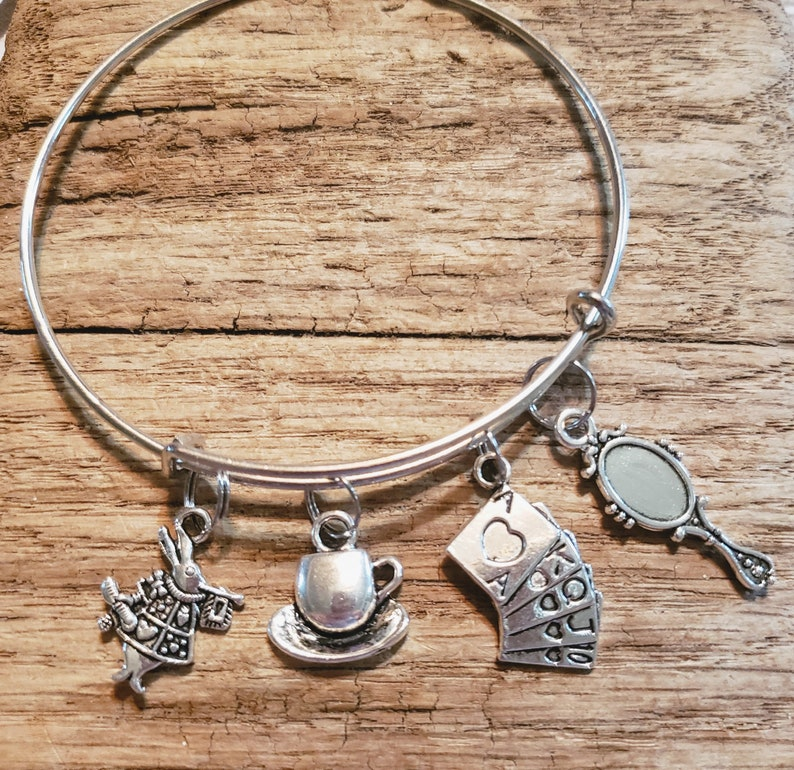 Alice in Wonderland charm bracelet the Mad Hatter looking image 0