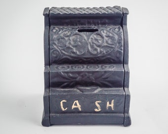 Vintage cast iron still cash register bank.