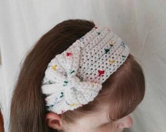 White multi-flecked crochet headband/headwarmer.