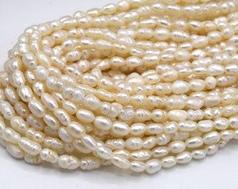 Perles de Culture d'Eau Douce Goutte Grain de Riz Ovale Blanc Ivoire Grade A