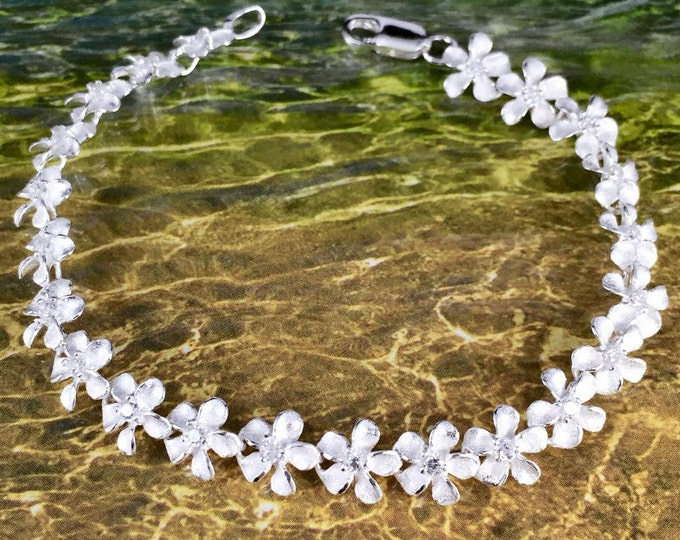 Featured listing image: Sterling Silver 9MM Hawaiian Plumeria with Clear CZ Design Bracelet (B1401_9mm)
