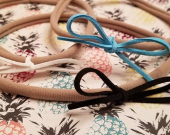 3 super soft nylon headbands with suede bows