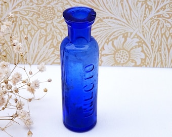 Antique cobalt blue INECTO hair dye bottle, rarer blue glass version, 1910s Hairdresser hair salon decor, beauty parlour decor, small bottle