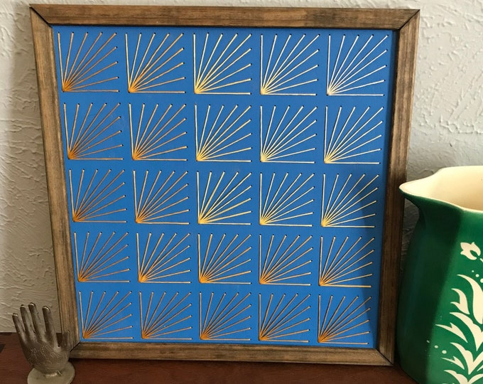 Yellow Ombré Fan with blue background Wall art